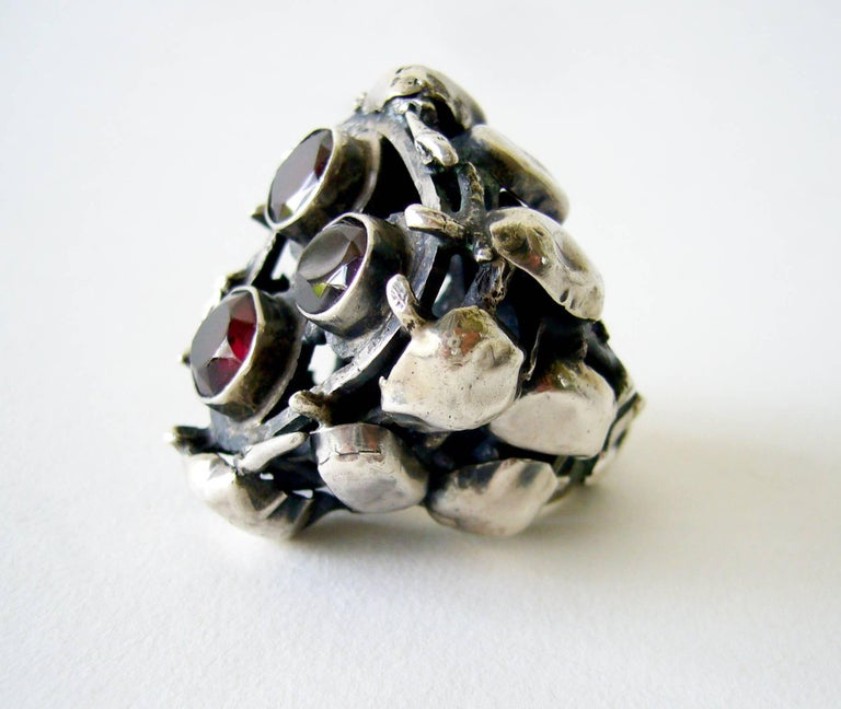 """Enormous sterling silver ring with three large bezel set garnets created by Israeli modernist jeweler, Rachel Gera.  Ring feature large scale fall color garnets is a finger size 7.75 to 8 and stands 7/8"""" off the finger and 1.5"""" in circumference."""