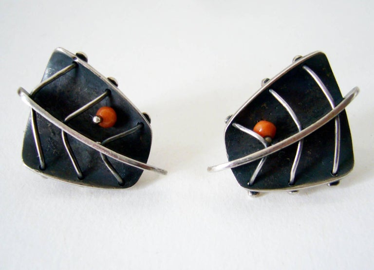 Sterling and coral bead abstract leaf earrings created by American modernist jeweler Ed Wiener of New York, New York.  Earrings are of the screw back variety and measure 1.25