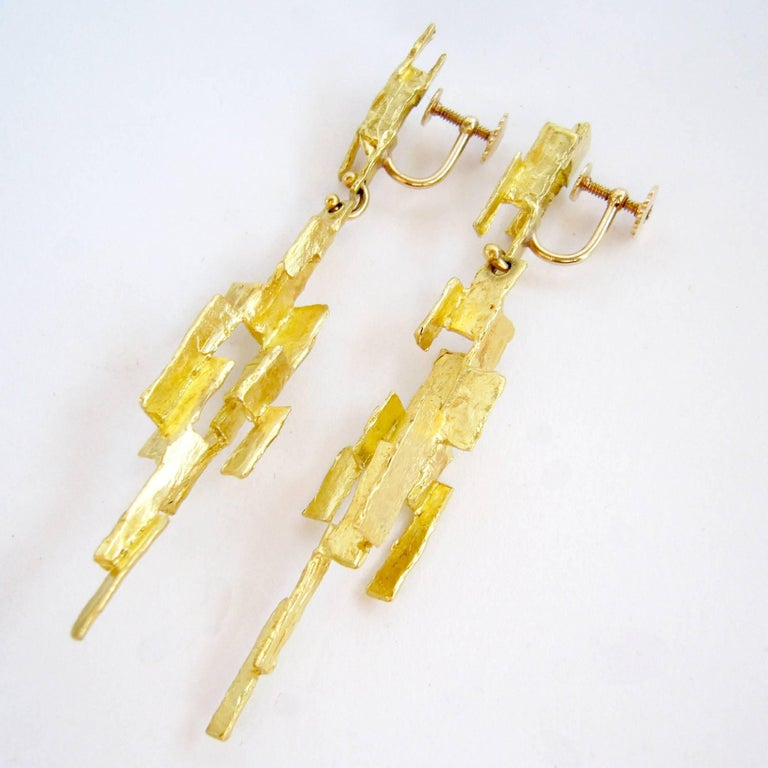 18k gold abstract modernist earrings designed and created by Ed Wiener of New York City, New York.  Earrings are of the screwback variety and can easily be converted for pierced ears.  They measure 3.5