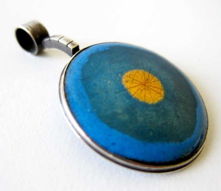 Enamel over sterling silver pendant created by James Parker of San Diego, California.   Parker was an early member of the San Diego Allied Craftsmen and known for his work in enamel. Pendant measures 2.5