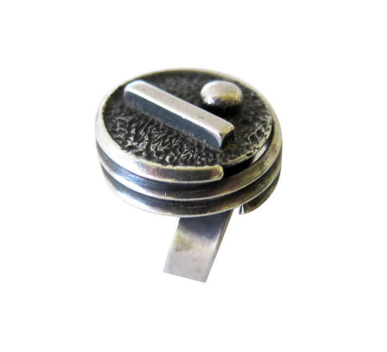 Sterling silver geometric modern ring created by San Diego studio jeweler, James Parker.  Ring is a finger size 7 and is signed with the conjoined JP hallmark, Hand Made.  Suitable for a man or woman and in very good vintage condition and from never