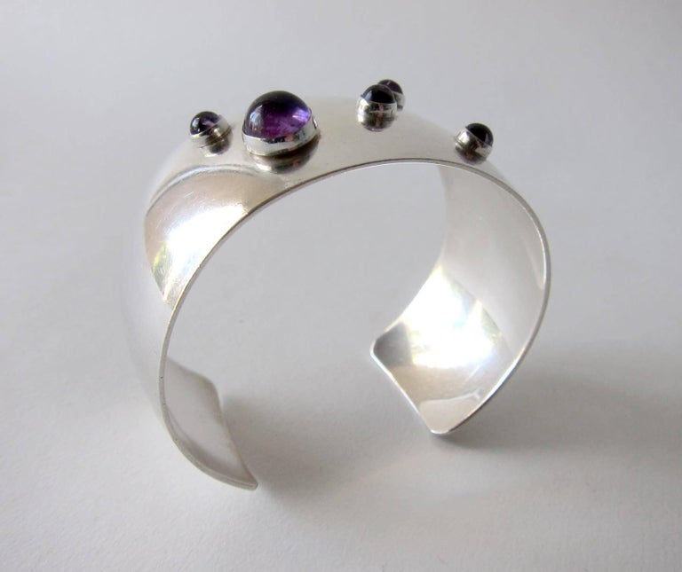 Sterling silver cuff bracelet featuring five amethyst cabochon stones created by Niels Erik From of Denmark.  Cuff measures 8