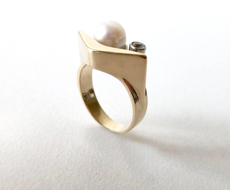 Handmade 14k gold ring featuring a 1950's boomerang design created by Everett MacDonald of Laguna Beach, California.  Ring is a finger size 6.75 to 7 and features a pearl with small diamond accent both set on a gold shank.  Signed MacDonald 14K and