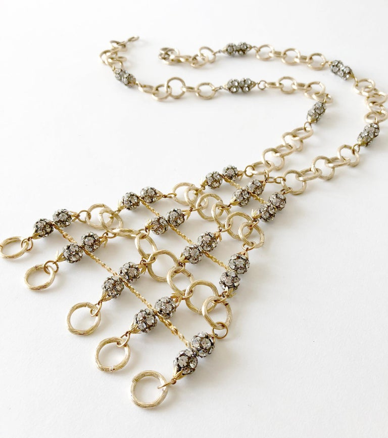 Gold toned aluminum and rhinestone glam statement necklace, circa 1960's. Necklace measures 22