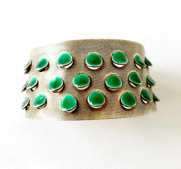 Iconic, lightly gold plated sterling silver bracelet with emerald green enameled scales or tabs created by Grete Prytz Kittelsen of Oslo, Norway.  Bracelet measures 1 3/8