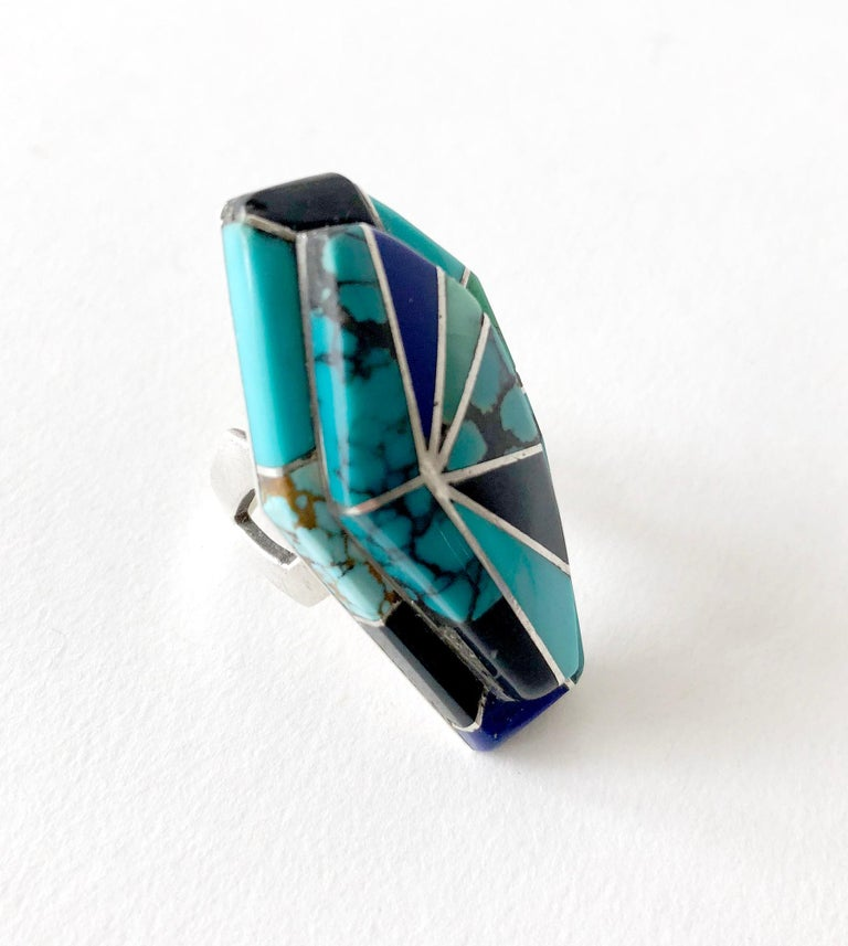 Custom made ring of turquoise, onyx and lapis lazuli inlaid in sterling silver and created by Richard Begay of Navajoland, Arizona.  Face of the ring measures 1.75