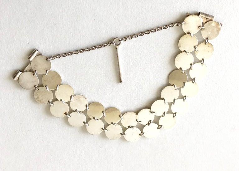Rare sterling silver chain maille disc bracelet created by Kalevala Koru of Finland.  Bracelet measures 7.5