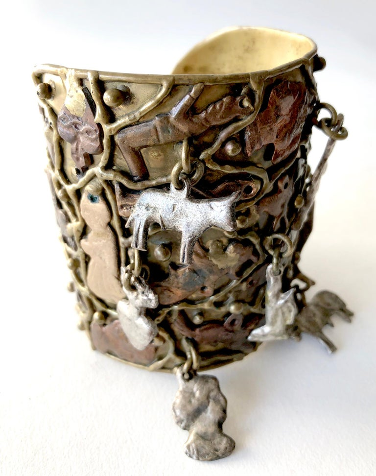 Handmade sculpture to wear, bronze cuff bracelet created by Pal Kepenyes of Acapulco, Mexico.  Bracelet is comprised of a heavily textured surface of milagros or