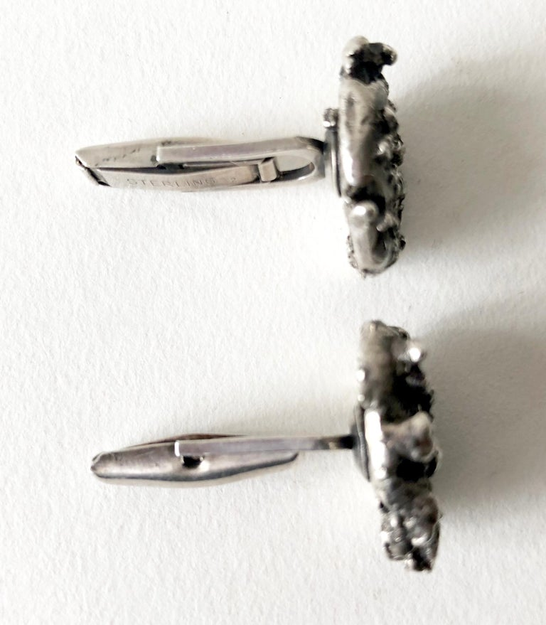 Abstract modernist cast silver cufflinks, circa 1960s.  Cufflinks measure 7/8