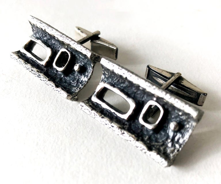 Brutalist cufflinks made by Canadian modernist jeweler Guy Vidal, circa 1970s.  Cufflinks are made of a pewter alloy, a mixture of pewter with other metals that was formulated by Vidal.  They measure 5/8