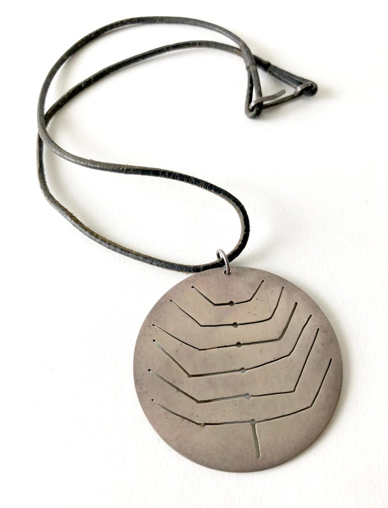 1950's sterling silver pendant with pierced abstract design created by Betty Cooke of Baltimore, Maryland.  Pendant has a 2