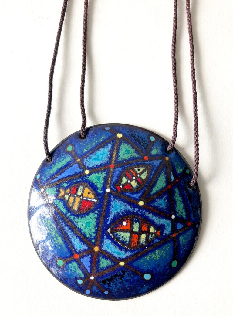 Abstract fish design in enamel over copper pendant necklace created by Barney Reid of San Diego, California.  Pendant measures 2 7/8