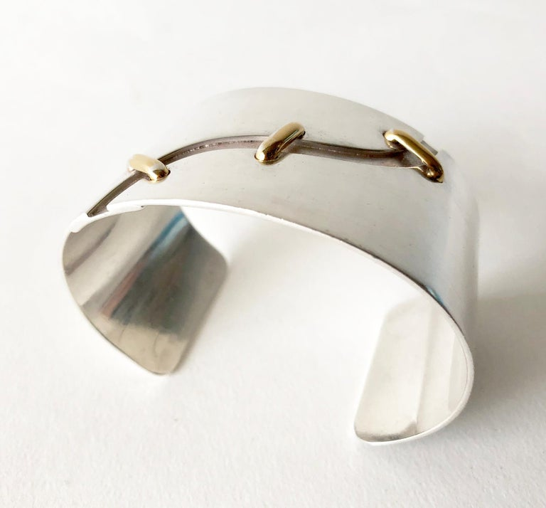 1970s sterling silver cuff bracelet with 14k gold 'stitched' accents created by José Maria Puig Doria of Barcelona, Spain.  Bracelet measures 7