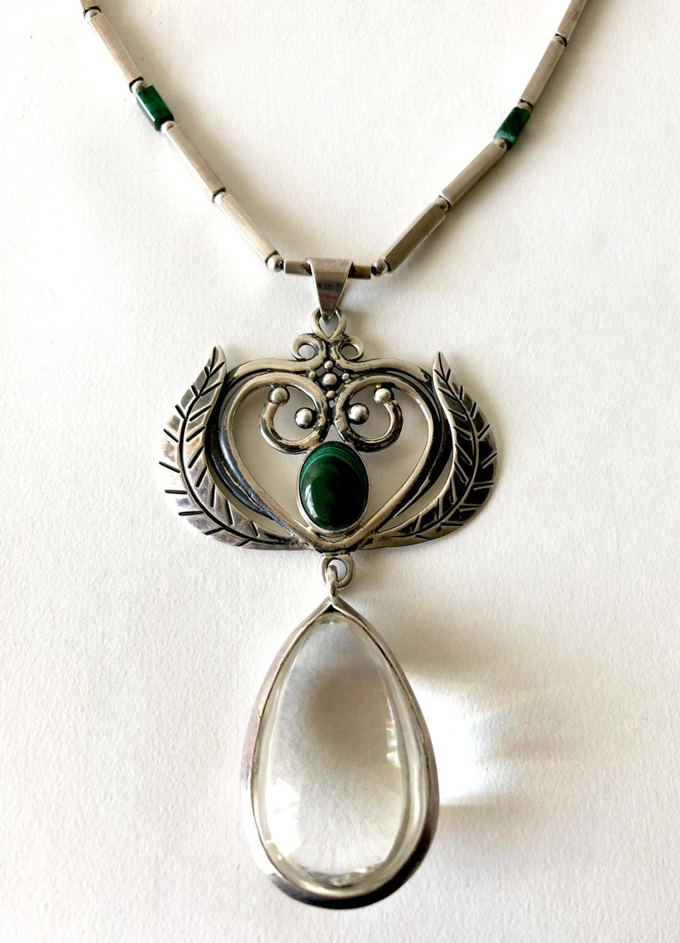 Rare, sterling silver necklace with malachite stone at pendant center and beads within the chain by Los Castillo of Taxco, Mexico.  Pendant also features a gorgeous large, bulbous, teardrop shaped rock crystal which measures 2