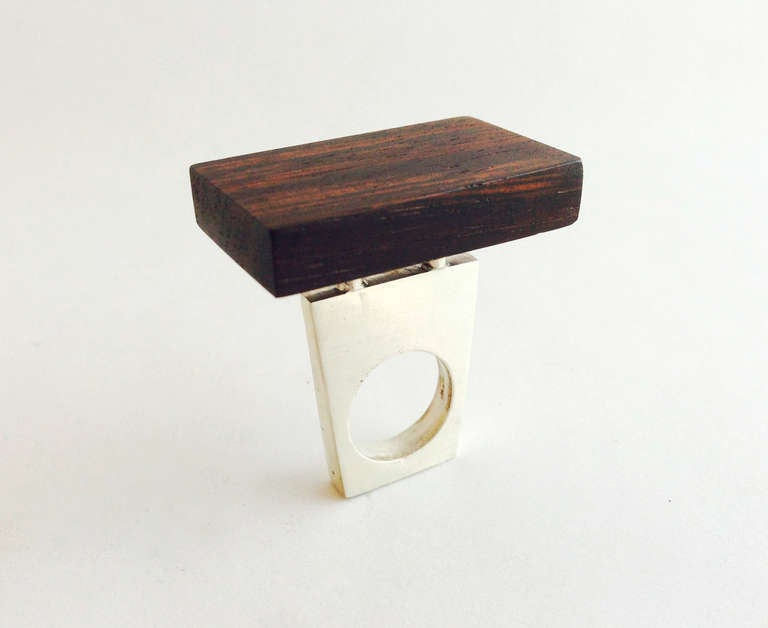 A sterling silver and rosewood ring by Heidi Abrahamson of Phoenix, Arizona. Ring features a large rosewood plank measuring 1