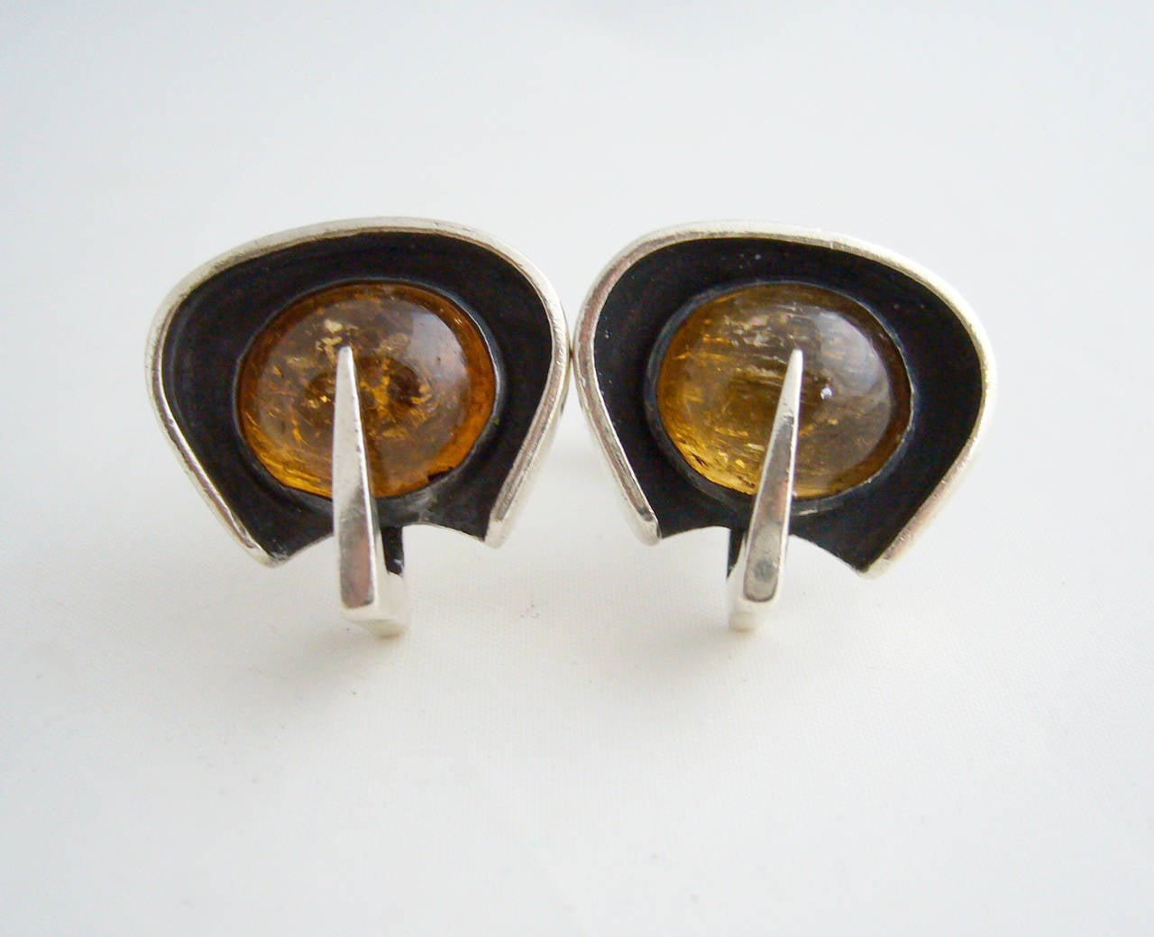 Sterling Silver and amber cufflinks attributed to Margaret DePatta of San Francisco, California.  Cufflinks measure 7/8
