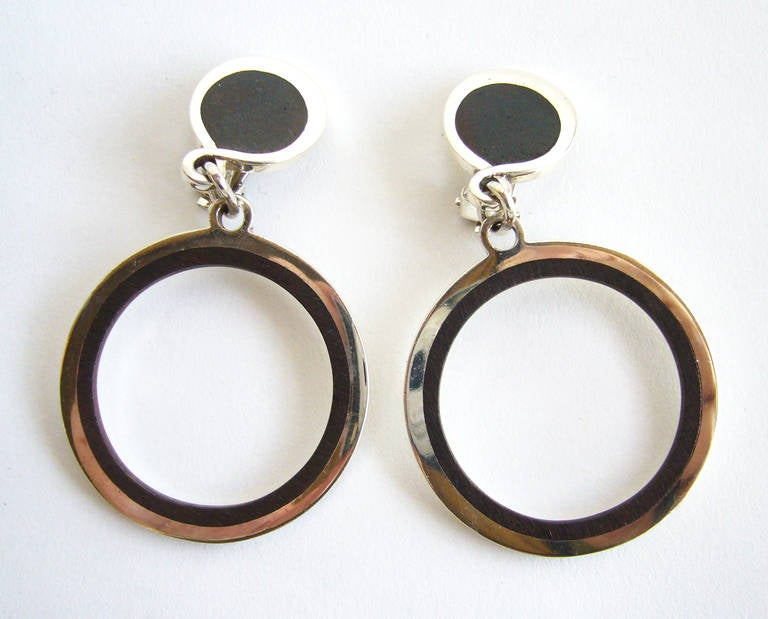 A 1970's pair of solid sterling silver and exotic wood earrings created by José Maria Puig Doria of Barcelona, Spain.  Earrings are clip back variety and are of superior quality.  Measuring  2.75