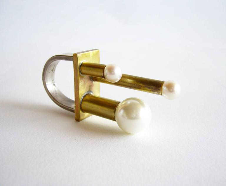 """Sterling silver, brass and pearl ring created by Heidi Abrahamson of Phoenix, Arizona.  Ring is a finger size 7.5 and sits 1.5"""" off the top of the finger.  Signed Heidi, 925 and in very good condition."""