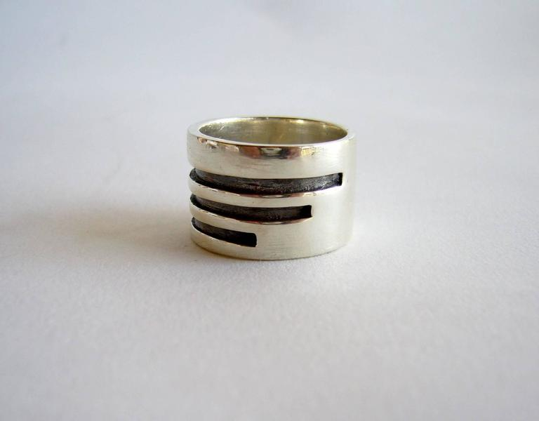 Sterling silver ring created by Idella La Vista of New York City, New York. Ring is a finger size 8.5 and suitable for a man or woman.  It measures 5/8