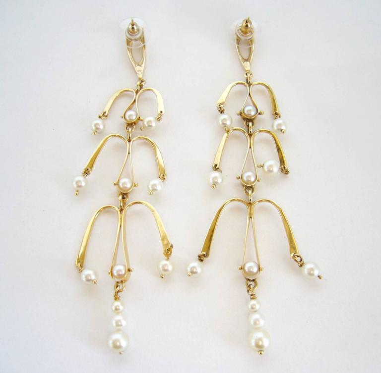 """14k Gold and pearl chandelier style earrings created by Ed Wiener of New York City, New York.  Earrings measure 4.5"""" in length and have been converted to pierced at some point.  Earrings are unsigned.  In excellent vintage condition."""