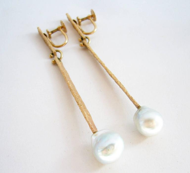 Textured 14k gold and grey mabé pearl earrings created by Ed Wiener of New York. Earrings measure 3