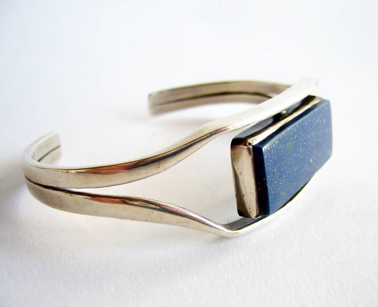Sterling silver and lapis lazuli cuff bracelet created by Jack Nutting of San Francisco, California.  Bracelet has a wearable wrist length of 8.5