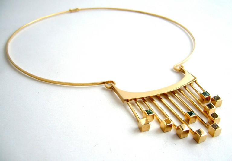 A rare, Finnish modernist 14k gold and tourmaline necklace designed by Paula Häiväoja and executed by master goldsmith,Timo Nupponen for Kaunis Koru.  14k gold collar with kinetic drop front fringe accented with square-cut greenish-blue