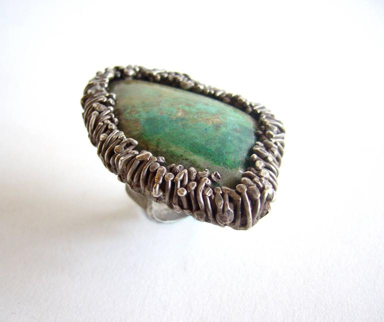 Large natural turquoise stone set in a silver textured frame created by Pal Kepenyes of Acapulco, Mexico.  Ring is a finger size 6 while the top of the ring measures 2