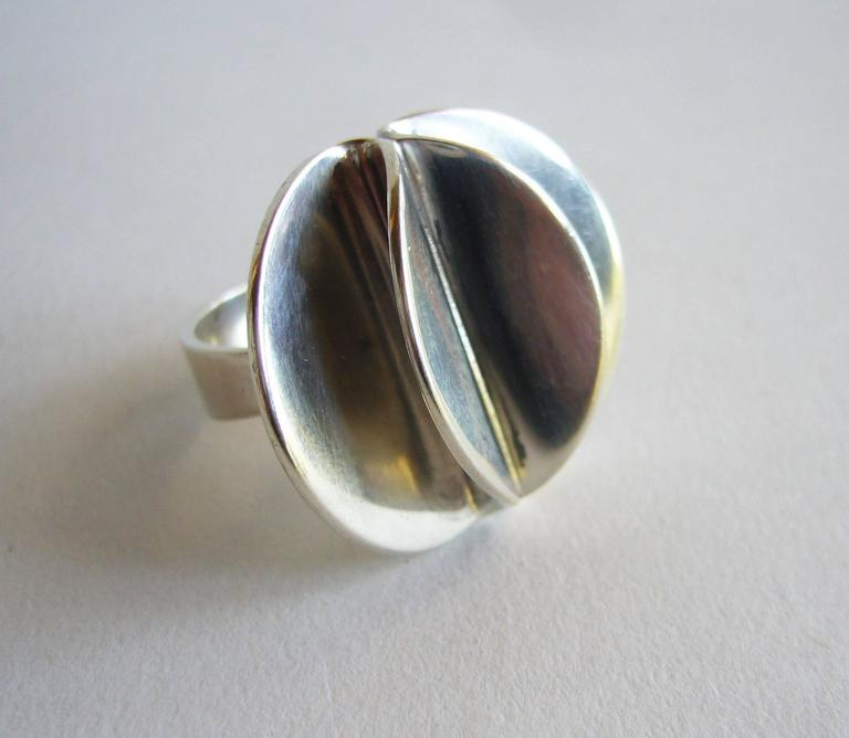 Sterling silver petal ring created by Theresia Horvselv for Alton of Sweden.  Ring is a finger size 4.5 and can easily be resized if need be.  A great, unconventional alternate to a modern day engagement or wedding ring.  Signed Theresia, Alton,