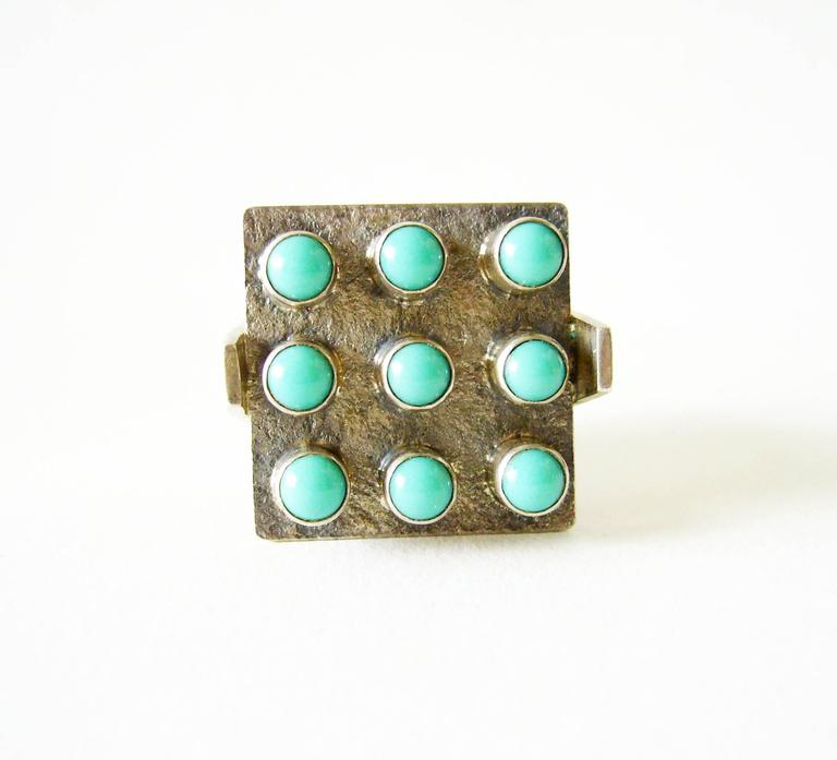 Silver and turquoise ring created by Master sculptor, painter and jeweler, Oswaldo Guayasamin of Ecuador.  Ring is a giner size 6 to 6.25.  Face of the ring measures 1