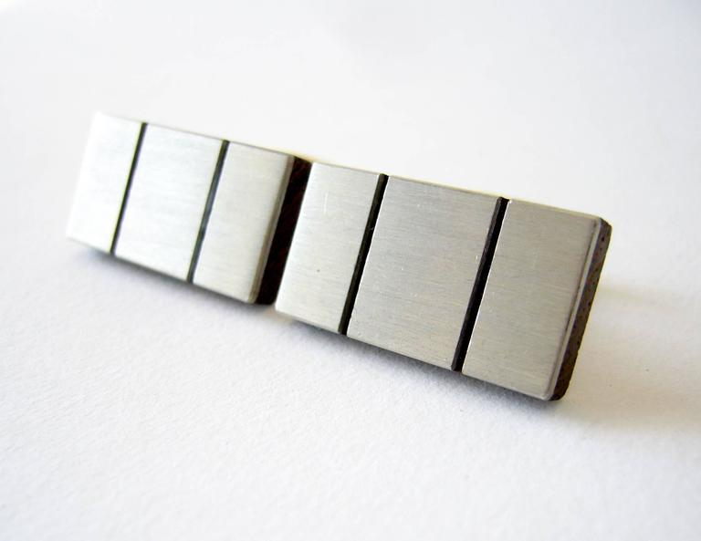 Brushed sterling silver and exotic wood modernist cufflinks, circa 1960's.  Cufflinks measure 1 1/16