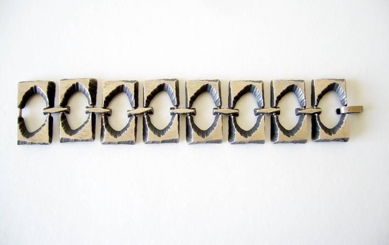 Sterling silver modernist bracelet by Karl Laine and Hans Sten of Finland.  Bracelet has eight rectangular brutalist panels linked together for a rocker look. Bracelet measures 8