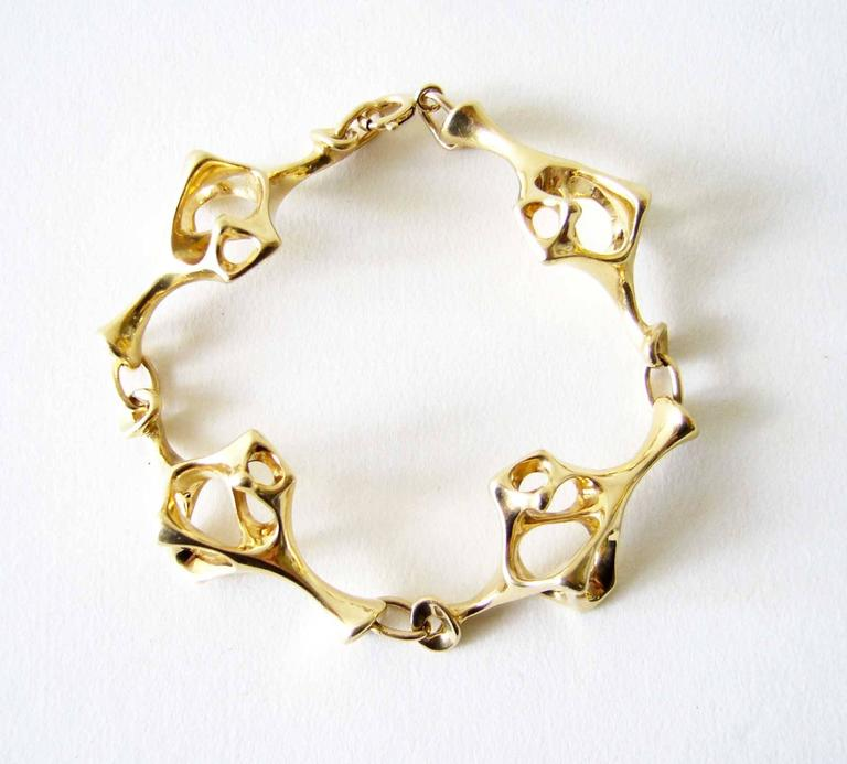14k gold skeletal link surrealist bracelet created by jeweler Everett MacDonald of Laguna Beach, California.  MacDonald is known for his exceptional jewelry making and sculpture.  He exhibited in the California Design 11 show at the Pasadena Art