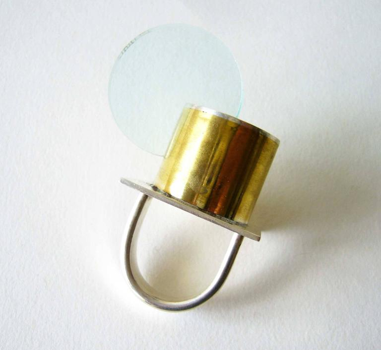 Sterling silver, brass and acrylic disc ring, part of a new Post Modernist series from Heidi Abrahamson of Phoenix Arizona. Ring is a finger size 7 to 7.25 and is signed Heidi, .925 and in excellent condition.