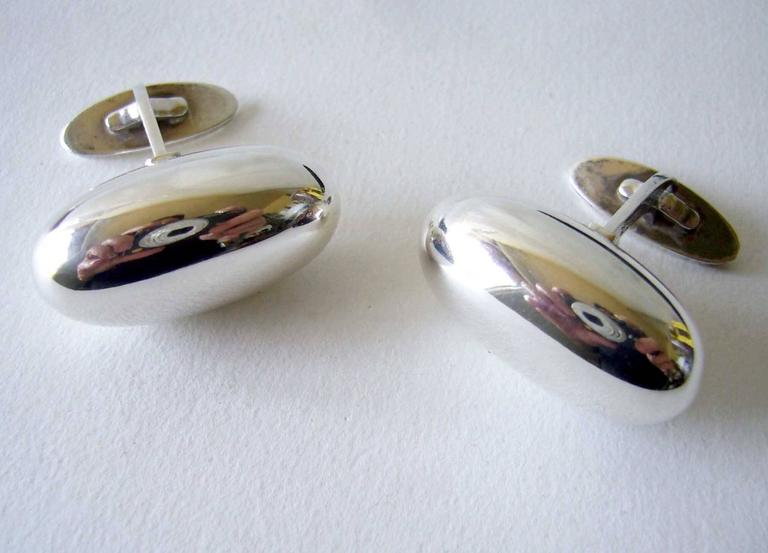 "A pair of sterling silver cufflinks designed by Vivianna Torun Bülow-Hübe for the Georg Jensen Silversmithy, Denmark.  Cufflinks are the longer version of this design measuring 1 1/4"" in length.  Signed Georg Jensen, Denmark, 925, design #121."