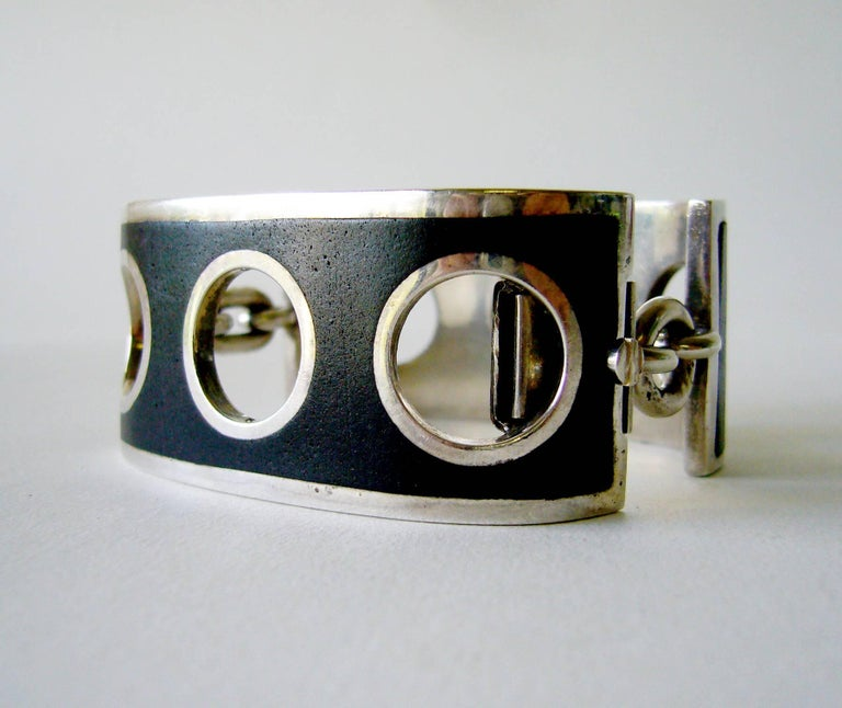Sterling silver with black inlay shackle bracelet designed and created by José Maria Puig Doria of Spain.  Bracelet has a bold, geometric design and has very good weight.  For a smaller sized wrist, inner circumference being 6.5