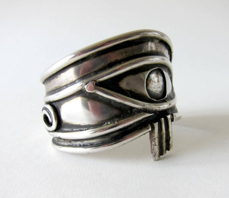 Handmade, sterling silver Eye of Ra bracelet circa 1970's.  Bracelet depicts the eye of the sun God, Ra and represents clairvoyance, omniscience, and a gateway into the soul.  It measures 7.5