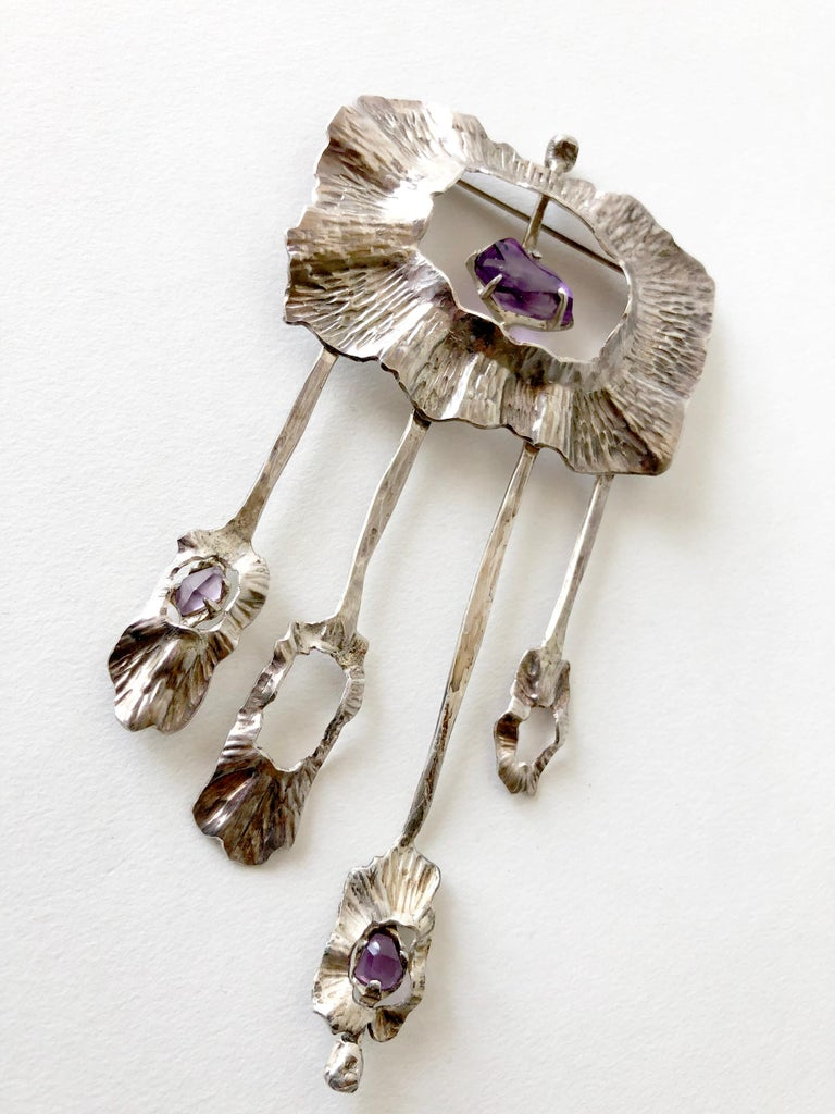 1970's California studio sterling silver and hand faceted amethyst brooch created by artist Mona Trunkfield of San Diego, California.  Brooch measures 4