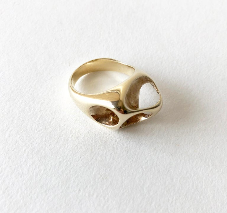 Amorphic, 14k gold crater ring created by Ed Wiener of New York, New York.  Ring is a finger size 6 and has a faint strike of 14K and the