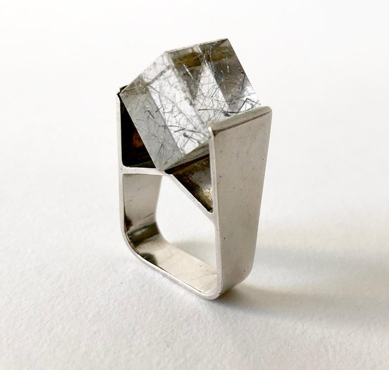 Tension set, rutilated quartz cube set created by Jens Christian Thejls of Denmark.  Ring is a finger size 5.75 to 6.25 and is signed Thejls, 925S, Denmark.  In very good vintage condition.