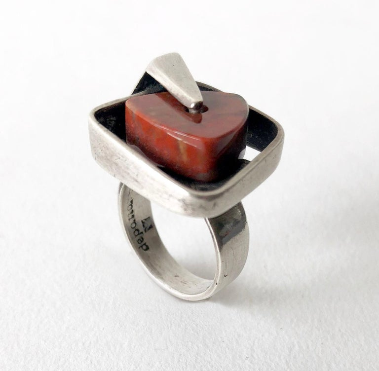 Sterling silver ring with triangular agate stone that spins within its setting, created by Margaret De Patta of San Francisco, California.  Ring is a finger size 6.5 to 7.  Signed De Patta and the artists' hallmark.  In very good vintage