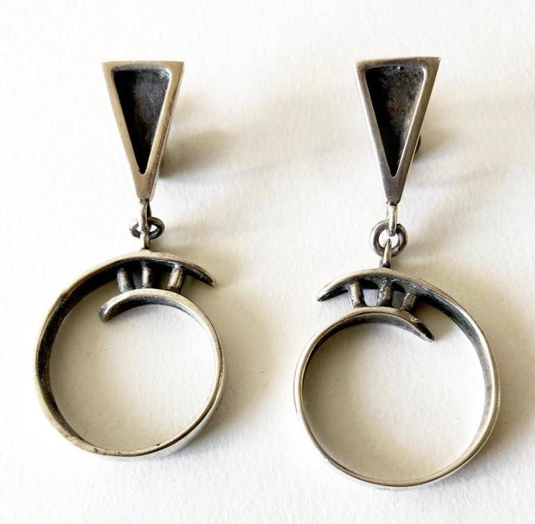 Sterling silver dangling screwback earrings created by Idella La Vista of New York, New York.  Earrings measure 2.25