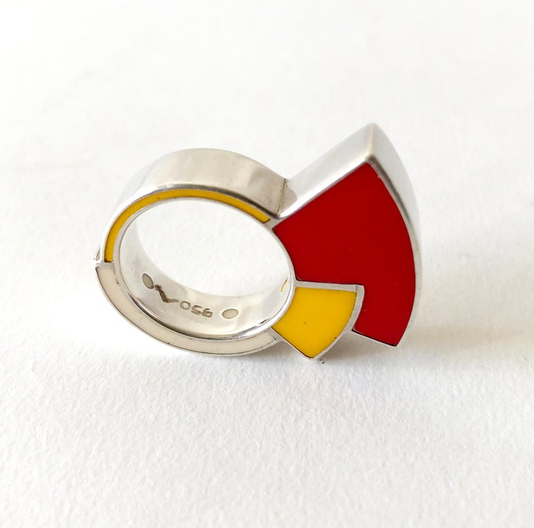 Post modern sterling silver and enamel ring, made in Italy circa 1980's.  Ring is a finger size 6.75 to 7.  It is signed 950 for sterling content with an artists mark of a stylized