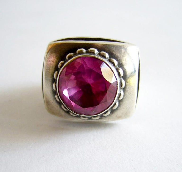 A sterling silver and faceted rubilite ring designed and created by James Parker of San Diego, California.  Ring is a size 9 and signed with Parkers conjoined JP.  Suitable for a man or woman.  In excellent original condition.