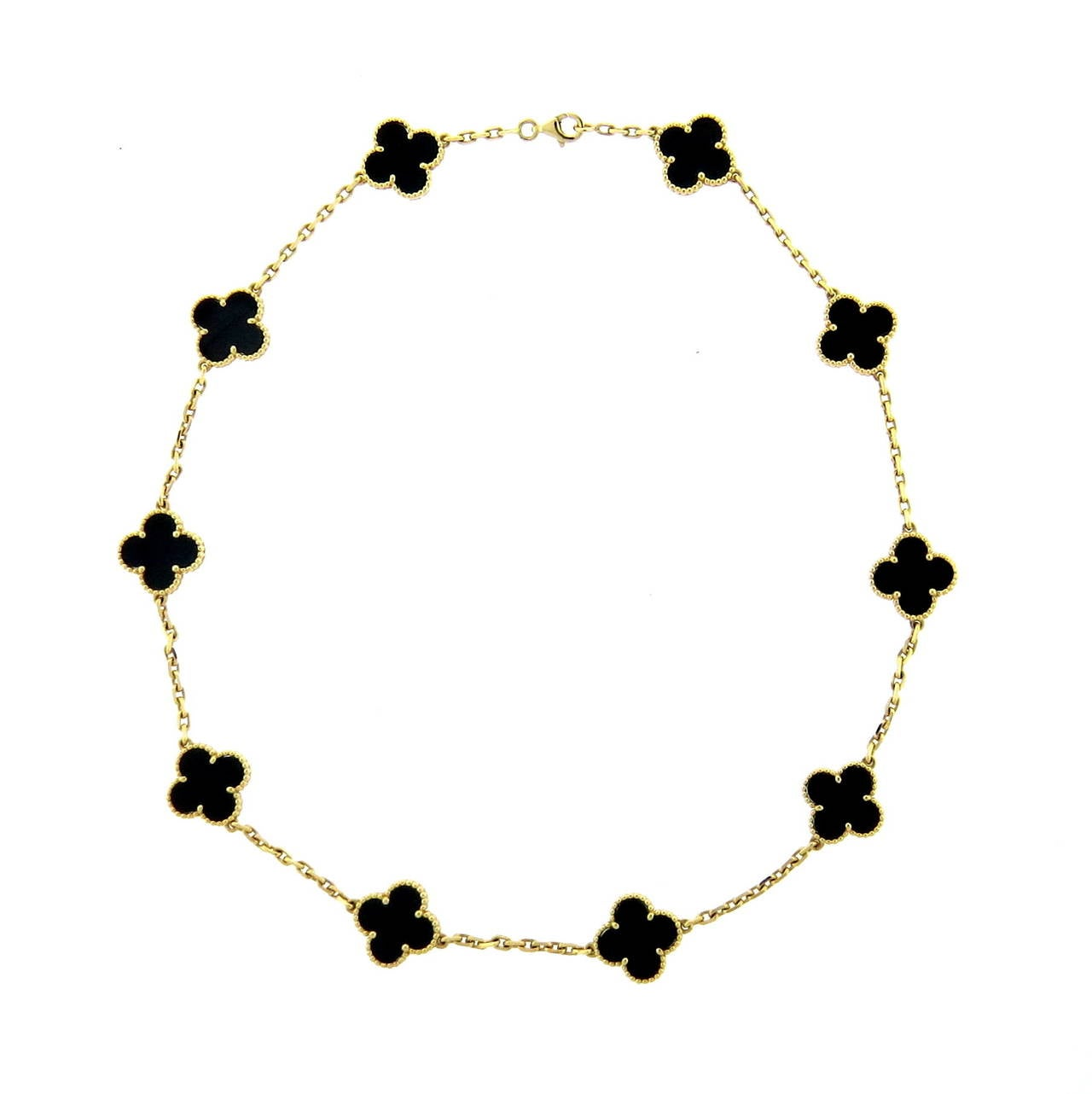 An 18k yellow gold necklace set with onyx clovers 15mm x 15mm.  Crafted by Van Cleef & Arpels for the Vintage Alhambra collection, the necklace measures 16.5
