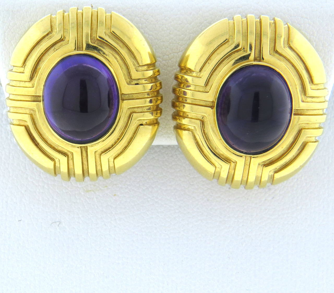 Tiffany & Co. 18k gold earrings,set with oval amethyst cabochons. Earrings measure 24mm x 21mm. Marked Tiffany & Co and 18k. weight - 23.9gr