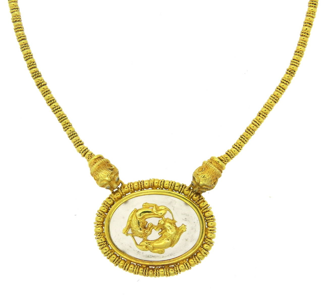 18k gold necklace by Ilias Lalaounis, featuring frosted crystal pendant and Chimera accents with diamond eyes. Necklace is 16 1/2