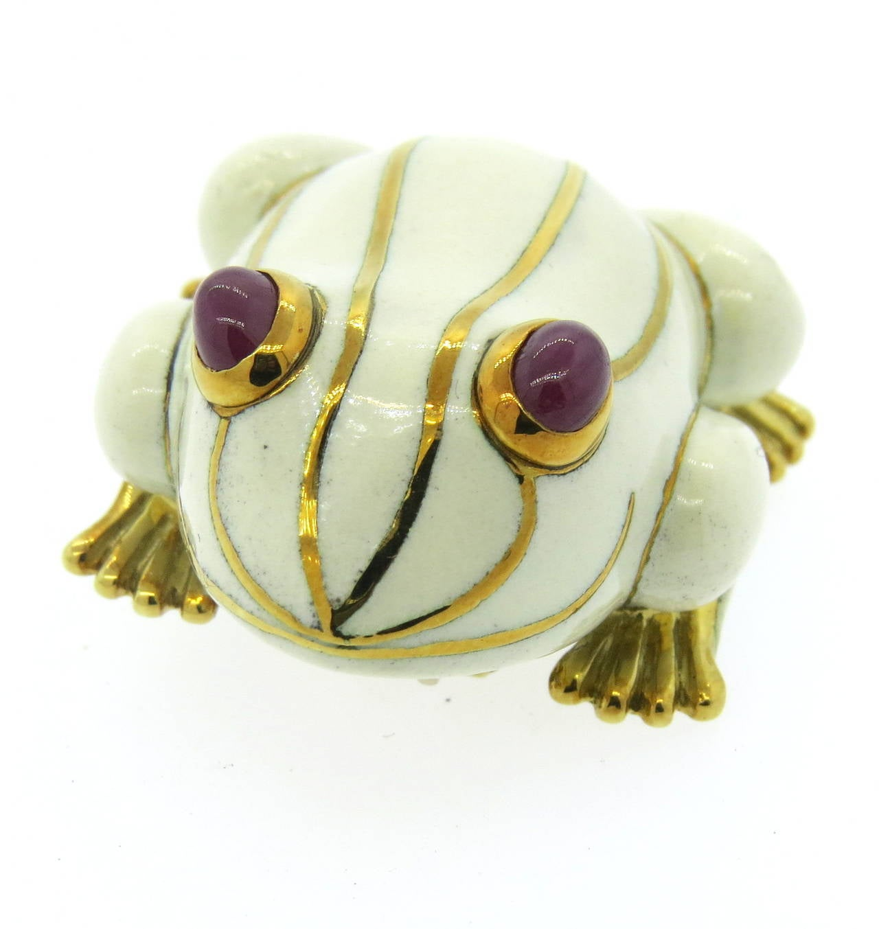 18k gold David Webb frog brooch, decorated with white enamel and ruby cabochon eyes. Brooch measures 43mm x 30mm. Marked Webb and 18k. weight - 41.7gr Current Retail Price $12,000.00
