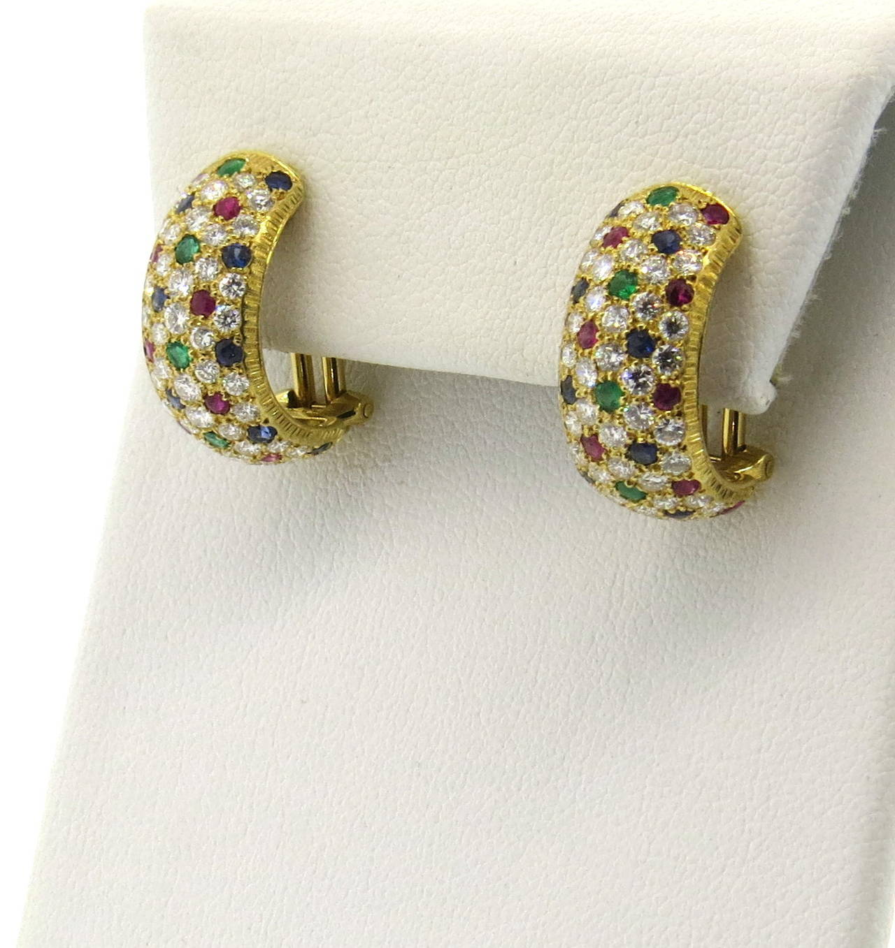 A Pair Of Lively 18k Yellow Gold Earrings Set With Shires Rubies And Emeralds