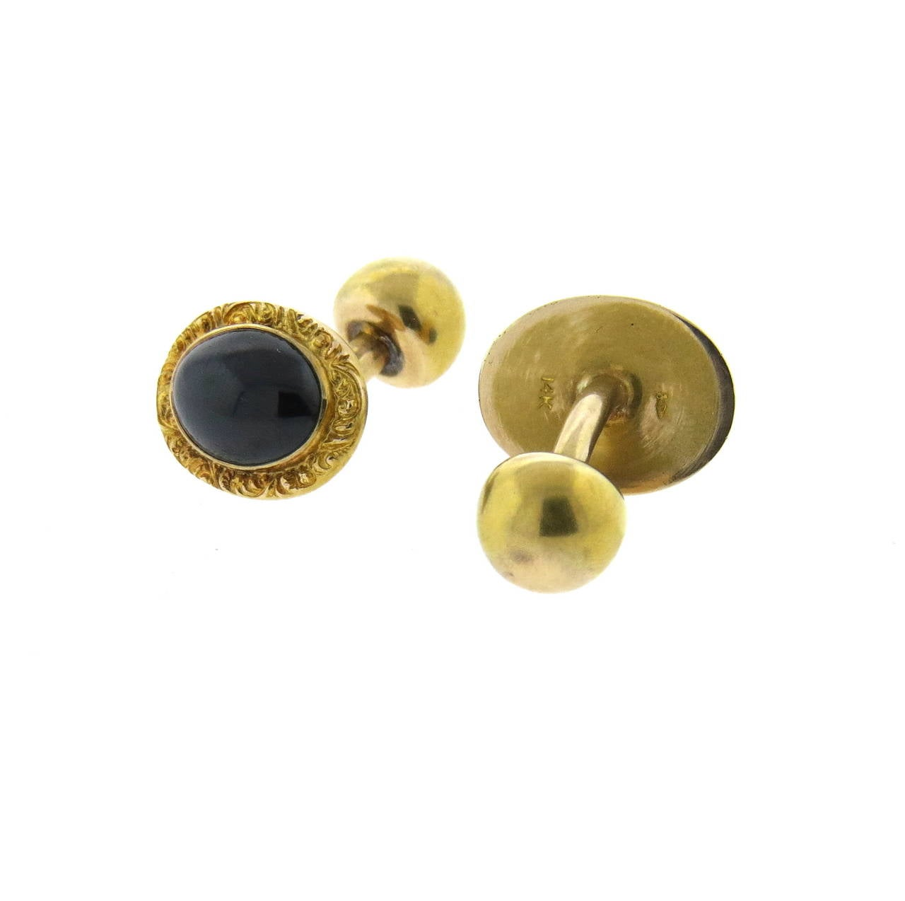 Antique 14k gold cufflinks with oval garnet cabochons, Cufflinks measure 16mm x 13mm. Weight - 7.1 grams